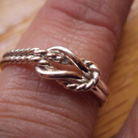 Etsy jewelry, ring, buckle knot, half twist, half plain, 16g thick, argentium sterling silver,