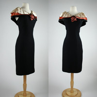 1960's black wiggle dress with satin cape collar and brown rosette rayon mid calf length sleeveless formal cocktail gown size Large size 10