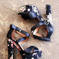 Black high-heeled strappy sandals with floral print platform and heel. | shopcuffs.com
