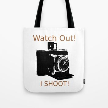 Watch Out, I Shoot Photos! Tote Bag by Claude Gariepy