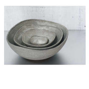 sara palomas nest bowls, 4 piece stoneware. modern rustic ceramics and pottery in a white texture glaze.