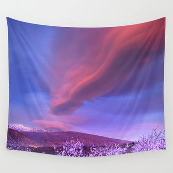 Lenticular clouds over Sierra Nevada and almonds Wall Tapestry by Guido Montañés