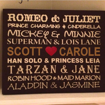 Personalized wooden sign with Famous couples by uniquevinyldesigns