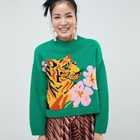 ASOS DESIGN tiger jumper with tropical flower at asos.com