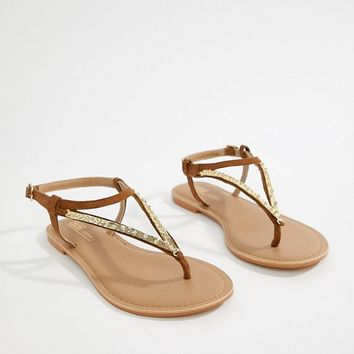 ASOS DESIGN Fixing Wide Fit Leather Embellished Flat Sandal at asos.com