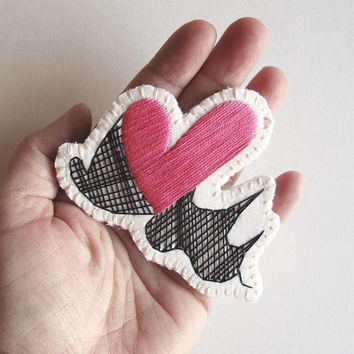 Hand embroidered brooch with heart geometric design using hot pink and black cotton thread An Astrid Endeavor textile fashion jewelry