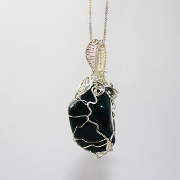 Lovely wire wrapped bloodstone pendant