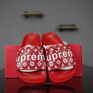 PEAP2Q lv x supreme 14ss slide sandals red white