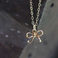 Supermarket: Tiny Gold Bow Necklace from Diament Jewelry