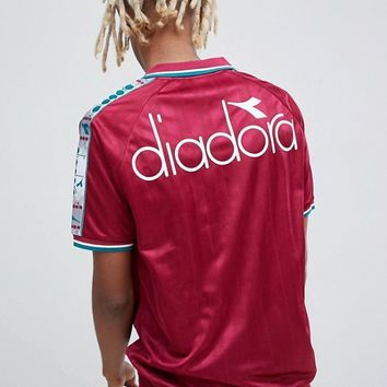 Diadora Offside retro T-Shirt with taping in red at asos.com
