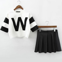 W Graphic Printed White Crop Top With Black Pleated Mini Skirt