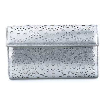 AZZEDINE ALAÏA | Laser-Cut Leather Clutch | Womenswear | Browns Fashion