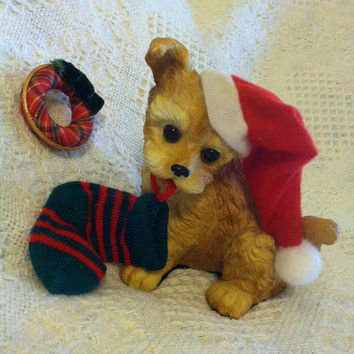 Dog Figurine Christmas Resin Dog With Red White Hat Holding a Green Red Stocking Holiday Themed Terrier Dog Statue Canine Lovers Home Decor