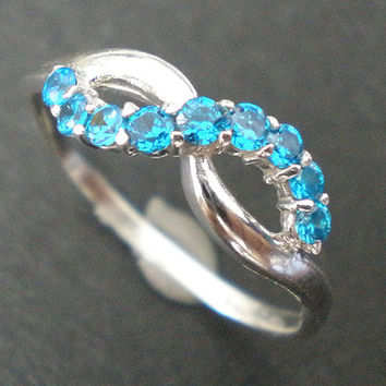 Gorgeous Infinity Knot Silver Ring - Aquamarine Blue Cz October Birthstone Trend