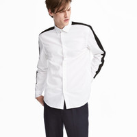 H&M Shirt with sleeve stripes $29.99