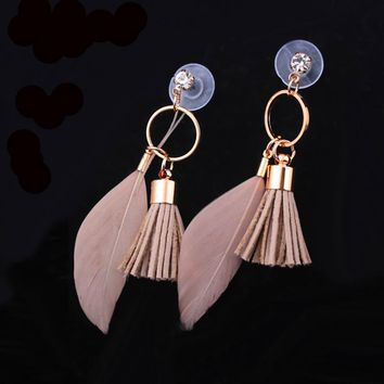 Beige tone tassel and feather dangling from gold tone stud earrings
