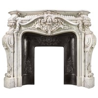 Rare, Monumental and Highly Ornate French Rococo Fireplace in Statuary Marble