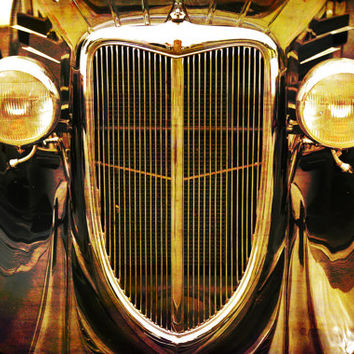 1930s Vintage car, front grill view, antiqued appearance, round headlights