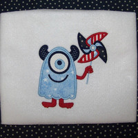 Patriotic monster applique with red white and blue pinwheel for a whimiscal July 4th touch on a baby bodysuit or toddler boy shirt