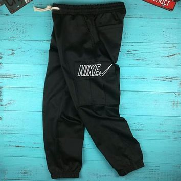 NIKE men and women with the same paragraph hollow embroidery big hook beam foot overalls F-AG-CLWM black