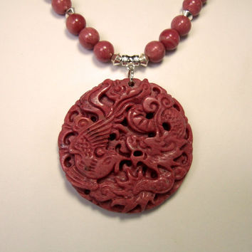 Hand Carved Rhodonite Gemstone Phoenix Bird Pendant Necklace Hand Beaded with Rhodonite and Silver Plated Bicone Beads