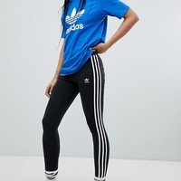 adidas Originals adicolor Three Stripe Leggings In Black at asos.com