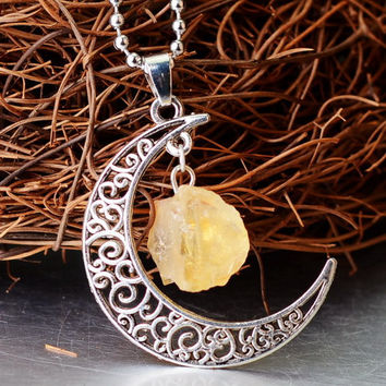 Citrine yellow raw stone and silver moon filigree pendant with silver chain necklace.