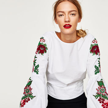 TOP WITH EMBROIDERED SLEEVES AND BOW IN BACK