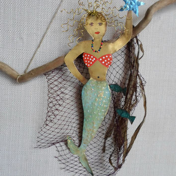 Mermaid on a wooden base