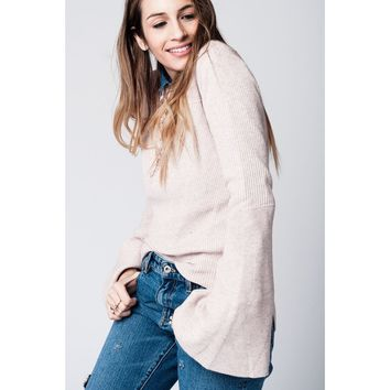Pink knitted sweater with bell sleeves