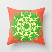 Green mandala on orange Throw Pillow by cycreation