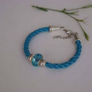 Kumihimo Braided Bracelet. Ocean Blue Waxed Cotton Cord Bracelet with Faceted Acrylic Bead.