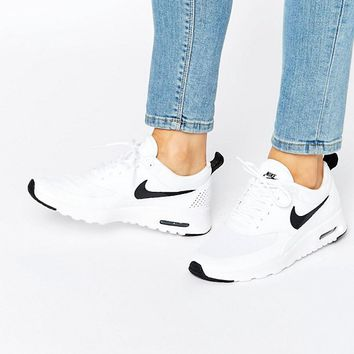 Nike Air Max Thea Trainers In White And Black at asos.com 78c40fc3b539