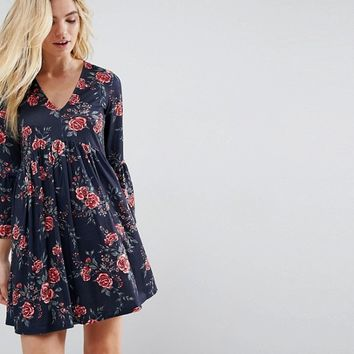 ASOS Smock Dress With V Neck and Trumpet Sleeve In Rose Print at asos.com