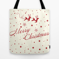 Merry Christmas.  Tote Bag by Irmak Berktas
