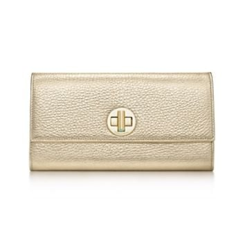 Tiffany & Co. -  City clutch wallet in gold grain leather. More colors available.