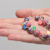 Bright handmade children's polymer clay wrist bracelet with beads and charms