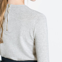 SWEATER WITH ZIP AT THE BACK
