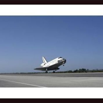 Space shuttle Atlantis approaching Runway 33 at the Kennedy Space Center in Florida., framed black wood, white matte
