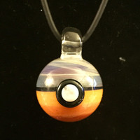 Glass Pokeball pendant (amber purple/oranges)