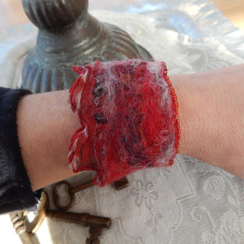 Bracelet: red and gray nuno felted silk and merino beaded cuff wrist warmer with adjustable copper clasp.  Boho style, casual wearable art