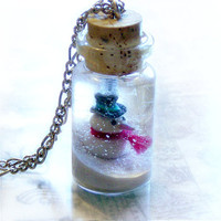 Bottle necklace with a snowman and a winter wonderland scene, snow globe, bottle pendant