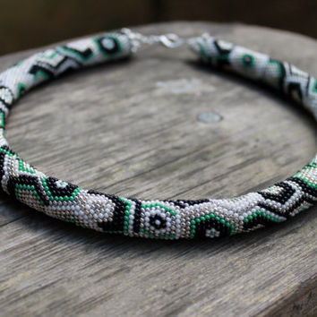 The 70-year trend  beaded crochet rope necklace, handmade jewelry, geometric pattern, silver, white, green, gray, black. Beadwork, gift