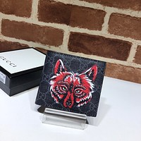 Gucci GG Supreme wallet with wolf
