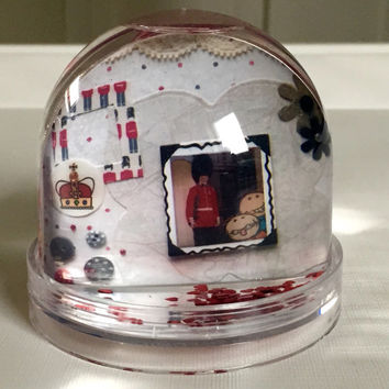 London themed snow globe with royal guard and lace