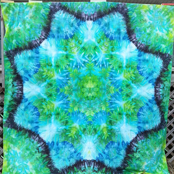 Giant madala tie dye tapestry in blue and green