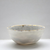Reduced price second stoneware Parian porcelain bowl in marbling white with mat gold rims mat interior and crystals.