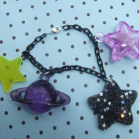 Magical galaxy Saturn and stars acrylic and resin space charm bracelet