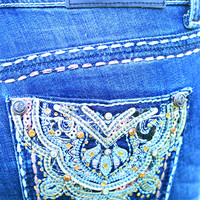 GRACE IN L.A. BRONZE MEDALLION BOOTCUT JEANS