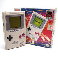 1989 Original Nintendo Gameboy. Handheld Portable Console In Good Condition. Includes Original Packaging and Instruction Booklet.